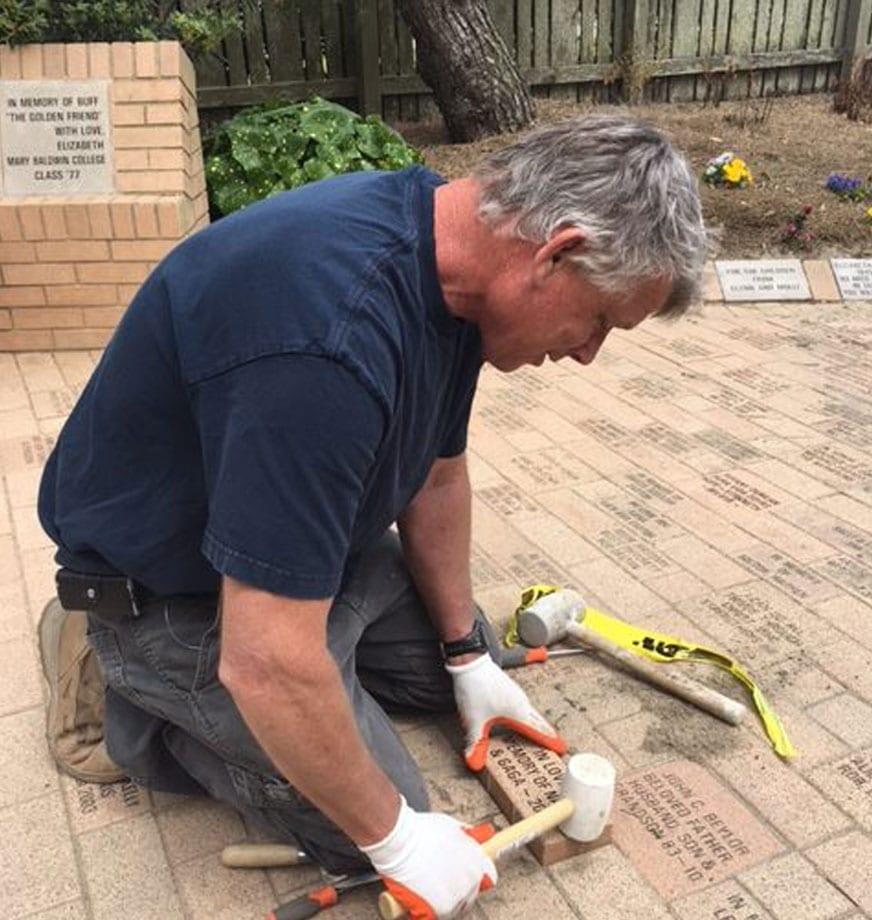 Person working on garden stones